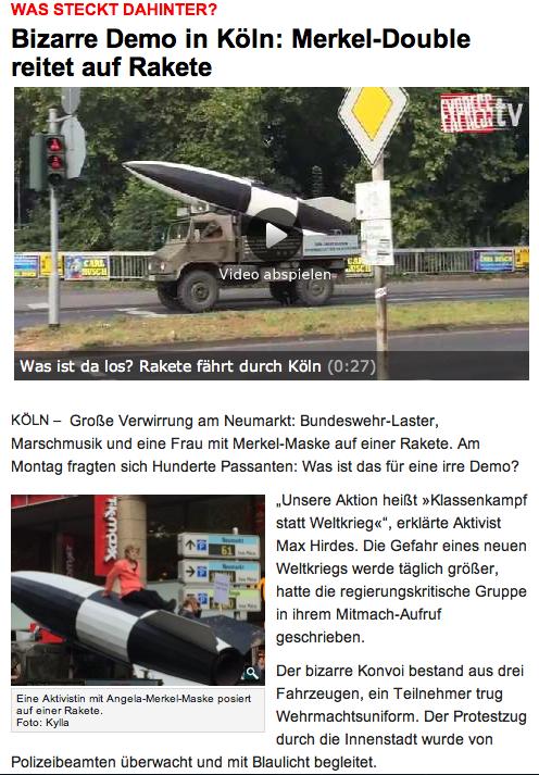 Screenshot von http://www.express.de/koeln/was-steckt-dahinter--bizarre-demo-in-koeln--merkel-double-reitet-auf-rakete,2856,28357580.html